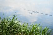 picture of fishermen  - Fisherman with a fishing rod on the river bank - JPG