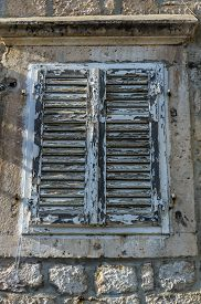 picture of louvers  - Wooden window with louvers in old house in the Perast Montenegro - JPG