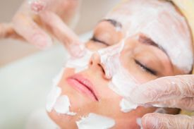 picture of beauty parlour  - Beautiful woman with facial mask at beauty salon - JPG