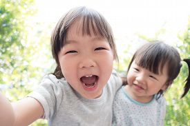 stock photo of selfie  - Happy child take a selfie in the park asian - JPG