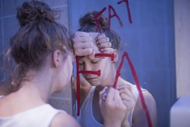 picture of bulimic  - Picture of bulimic girl and red writing fat on mirror - JPG