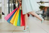 Girl In Shopping Mall With Bags poster