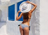 Sexy Back Of A Beautiful Tanned Slim Woman In Bikini On White And Blue Background. Mediterranean Arc poster