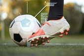 sport, football and technology - soccer player playing with ball on field poster
