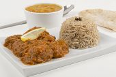 stock photo of tadka  - Meat madras served with pilau rice - JPG