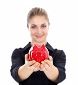 foto of piggy_bank  - Lovely woman offering us a red piggy bank - JPG