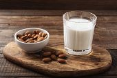 Close Up Almond Milk On Wooden Background. Concept Of Lactose-free Dairy Products poster