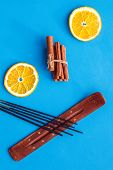 Citrus And Cinnamon Fragrance Diffuser For Air Freshness On Blue Background Top View poster