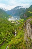 Cruise Ship In Geiranger Seaport, Norway. End Of The Famous Geiranger Fjord, Norway With Cruise Ship poster