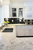 stock photo of quartz  - Bright kitchen with quartz counter tops and modern - JPG