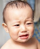stock photo of pouty lips  - baby crying - JPG
