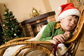 picture of have sweet dreams  - Image of innocent child having a snap on rocking chair on xmas evening - JPG