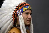 stock photo of indian chief  - Portrait of a native american in a studio - JPG
