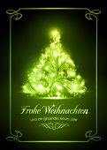 stock photo of weihnacht  - Warmly sparkling Christmas tree on dark green background of 5x7 inch - JPG