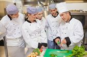 image of scallion  - Trainees learning vegetable slicing in the kitchen - JPG