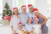 stock photo of father time  - Happy family posing for photo at christmas - JPG