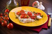 stock photo of hake  - Fish fillet with cherry tomatoes and olive - JPG