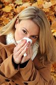 Woman With Cold  Blowing Her Nose