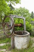 stock photo of heatwave  - Old abandoned drought rusty draw well - JPG