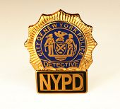 pic of nypd  - nypd police detective badge close up on white background - JPG