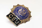 image of nypd  - nypd police detective badge close up on white background - JPG