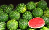 pic of watermelon  - Many big sweet green watermelons and one cut watermelon - JPG