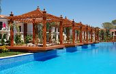 picture of pergola  - Summer landscape on luxury resort with swimming pool and wood pergola - JPG