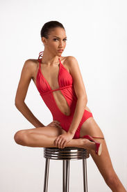 foto of monokini  - Young slender female fashion model of mixed Creole and African - JPG