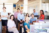 foto of employee  - Portrait Of Businesspeople In Modern Open Plan Office - JPG