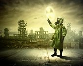 image of radioactive  - Image of man in gas mask and protective uniform touching radioactivity sign - JPG