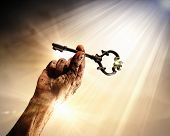 picture of struggle  - Key in human hand - JPG