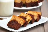 stock photo of brownie  - Chocolate Peanut Butter Brownies with a glass milk - JPG