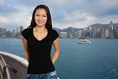Joyful girl on the background of Hong Kong. Mixed race Asian Caucasian girl.