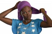 picture of burka  - Young african woman putting her bandana on Studio Shot - JPG