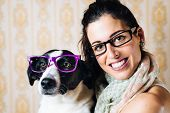 stock photo of dog eye  - Funny woman and cute dog wearing glasses - JPG