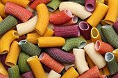 stock photo of pene  - Background image of traditional colorful italian pasta - JPG