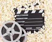 movie clapper board with popcorn