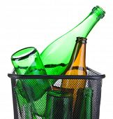 Glass bottles in recycling bin isolated on white