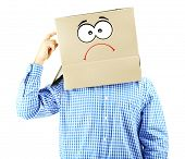 image of incognito  - Man with cardboard box on his head isolated on white - JPG
