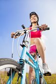 Mountain Woman Biker And Blue Sky Background