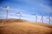 image of turbines  - Wind Turbines in Central California produce electricity with the power of the wind - JPG