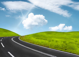pic of long winding road  - a long and winding road among the hills - JPG
