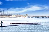 stock photo of hydroelectric  - hydraulic structure hydroelectric power station on the winter river - JPG
