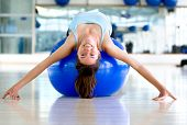 image of bending over backwards  - Gym woman bending backwards over a pilates ball - JPG