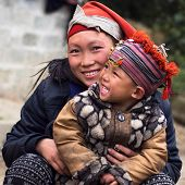 stock photo of traditional attire  - Happy Hmong woman and child smiling - JPG