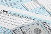 pic of cpa  - USA 1040 Tax Form with two 100 US dollar bills - JPG