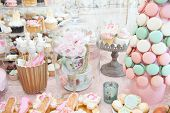 image of pastel colors  - Wedding decoration with pastel colored cupcakes - JPG