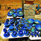 stock photo of pottery  - Greek pottery shop with bright blue ceramics Crete - JPG