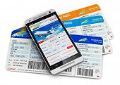 image of boarding pass  - Modern touchscreen smartphone or mobile phone with airline internet web site offering booking or buying airliner tickets online isolated on white background with reflection effect - JPG