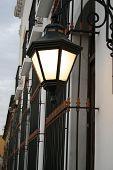 image of hacienda  - Vintage street lamp adorns main entrance of a mexican old house - JPG